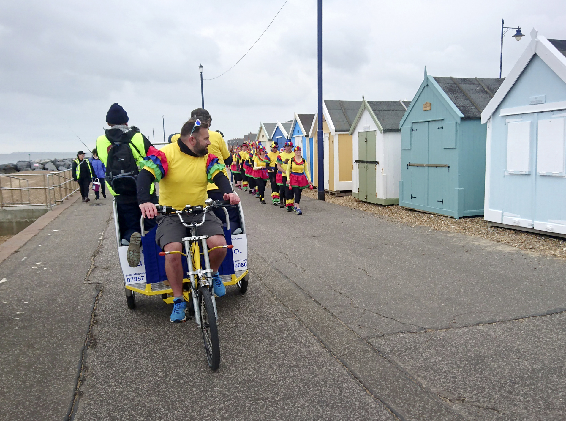 Ian from Suffolk Rickshaw Company cycled ahead of the conga line and carried the team of volunteers doing the filming